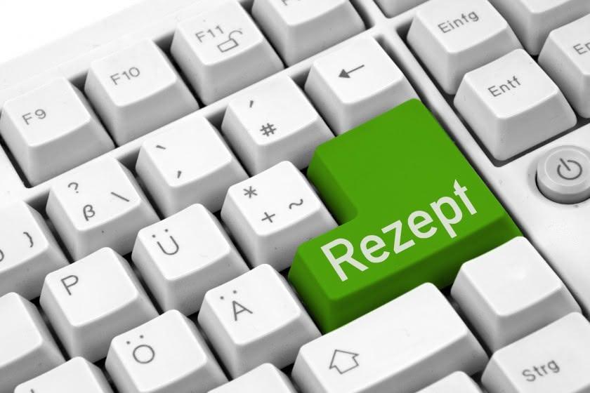 """Tastatur mit grüner Taste auf der """"Rezept"""" steht"""